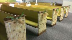 Bamboo gossamer from Shindigz on sides of pew