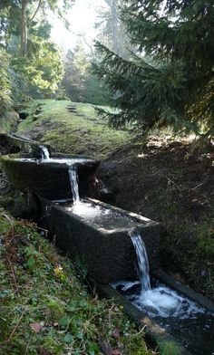 maybe we could end up with a water feature like this to accent the dry creek on the hillside.