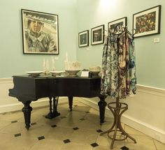 In our entrance hall - walls feature work by current students, the piano has a collection of white ware by Alex Allpress and the hallstand is draped with scarves by Cassandra Hone