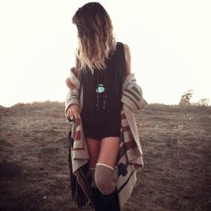 Festival style.  Oversized sweater, long necklaces and thigh highs with tall boots.