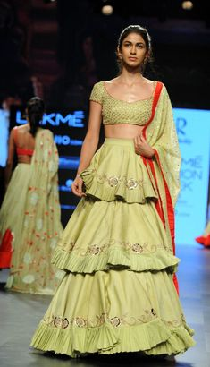 A model showcases a creation by designer Divya Reddy at the Lakme Fashion Week Summer Resort 2017 in Mumbai on February / AFP / Sujit JAISWAL Buy Designer Collection Online : Call/ WhatsApp us on : Indian Wedding Outfits, Indian Outfits, Indian Clothes, Wedding Dress, Dress Indian Style, Indian Dresses, Choli Designs, Blouse Designs, Indian Designer Outfits