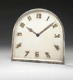 AN ART DECO SILVER DESK CLOCK, BY CARTIER
