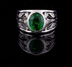 Custom designed and fabricated green tsavorite ring in sterling silver with 14k yellow gold accents.