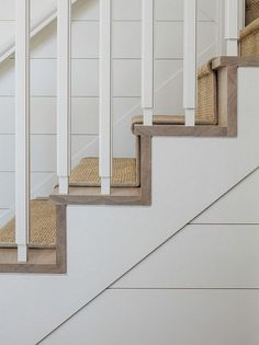 Ship lap walls, hardwood stair treads with sisal runner