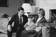 Prince Charles and Diana, Princess of Wales hold their baby son, Prince William at Kensington Palace in London on 22nd December 1982.