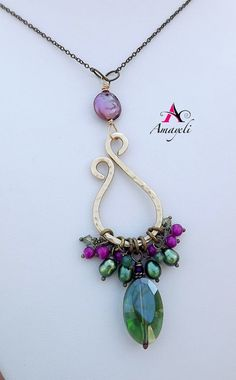Artisan bohemian style long mixed metal necklace by Amayeli
