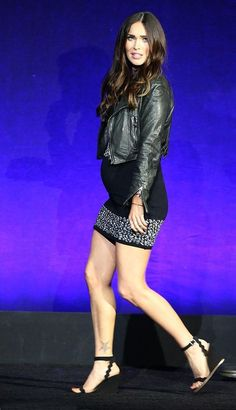 Megan Fox is pregnant! Sources confirm to PEOPLE that Fox, 29, is expecting her third child.The mother-to-beshowed off her baby bump wearing a black Versace dress at CinemaCon in Las Vegas on Monday where she and costar Will Arnett promoted their new movie Teenage Mutant Ninja Turtles: Out of the