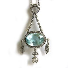 I'm researching antique jewelry for a Gilded Age novel I'm writing and I came across this diamond and aquamarine pendant by Faberge, c. 1900.