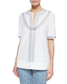 Tory Burch Embroidered Poplin Tunic, White/Blue -- I'm sorry, the pants HAVE to go...other than that, I think this top could look really great with the right jeans/pants/shorts and the right shoes and accessories.