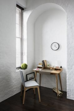 Small spaces, laptop desk, writing desk, built-in wall space, white walls, natural lighting, creative space usage.