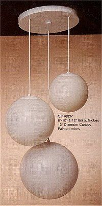 """Multi-Globe Pendant Lighting, 3 globes, Acrylic globes in 10"""" 12"""" and 14"""" one 100 watt, two 150 watt max bulbs $210.  There is a smaller version with 8 10 and 12 inch glass globes which takes one 100 watt, one 150 watt and one 200 watt bulbs for 360.  Because this is right by the stair, perhaps something not as breakable as glass is a good idea."""