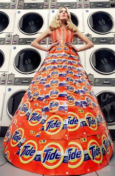 Not sure what to do with your old washing detergent boxes? Why make yourself a couture ballgown of course!