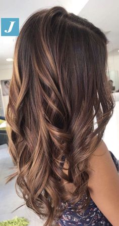 Mary transitioned this client from a brassy grown out highlight to fluid gold balayage