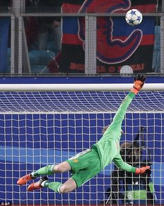 Manchester United's goalkeeper David de Gea makes a save to deny a top corner bound shot from Seydou Doumbia