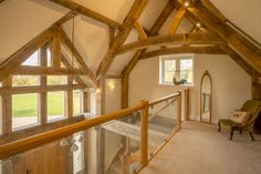 Grand entrance with oak beams in four bedroom oak frame house in Cotswolds Barn Conversion Interiors, Farmhouse Stairs, Oak Frame House, Arch House, Attic Bedrooms, Timber House, Dream House Exterior, Staircase Design, Beams