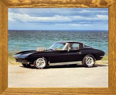 This beautiful 1963 Chevy Corvette Coupe classic vintage car print framed poster will definitely helps in creating a cheerful ambiance into your home. This framed poster captures the image of black Chevy Corvette Coupe Classic vintage car parked near the ocean beach which is sure to attract lot of attention and add a classic look to your home décor. Its wooden brown rust frame accentuates the poster mild tone. The frame is made from solid wood measuring 19x23 inches with a smooth gesso…