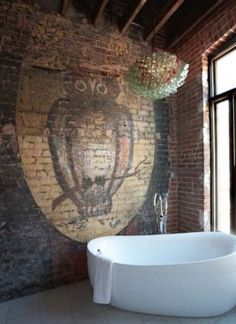 i absolutely LOVE this tub!  the muted owl mural on the brick wall gives a little drama.  i'm not fond of this light fixture in this room...just does not work.
