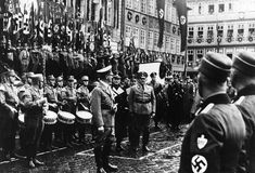 Nazi units marching past Adolf Hitler on the occasion of the 13th anniversary of the 'SA March on Coburg'.