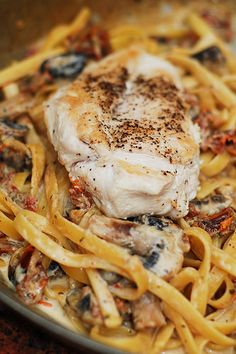 Pasta with chicken, mushrooms, sun-dried tomatoes in a creamy garlic and basil sauce | by JuliasAlbum.com