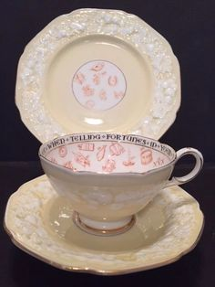 PARAGON FORTUNE TELLING SIGNS OMENS ART DECO CHIPPENDALE TEA CUP TRIO YELLOW sold for £360 in March 2016