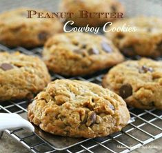 Peanut Butter Cowboy Cookies - I've never outgrown the thrill of warm gooey chocolate filled cookies and a glass of cold milk. I fully intend to keep it… Pecan Cookie Recipes, Butter Pecan Cookies, Peanut Butter Recipes, Cookie Desserts, Just Desserts, Delicious Desserts, Dessert Recipes, Yummy Food, Cookie Butter