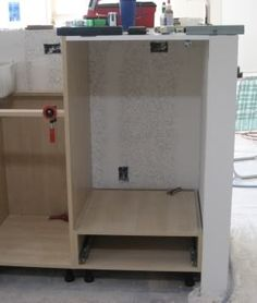 Raised dishwasher with cabinet beneath diy projects for - Ikea corner cabinet door installation ...