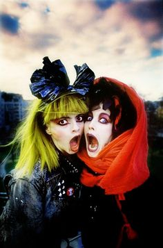 Nina Hagen and Lene Lovich by Derek Ridgers - on the roof of Arista Records overlooking Cavendish Square Gardens, London 1987. Photographed for the NME.