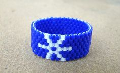 Snowflake beaded ring in cobalt blue and white  by ElephantBeads, $18.00