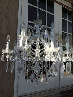 Beautiful Maria Theresa Chandelier - This is a 12 light (4 arm with 3 lights), dripping with heavy glass crystals, silver frame surrounded by glass