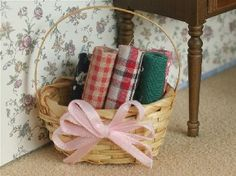 Rolls Of Fabric In Basket (SA28) - Accessories. Over 10,000 similar dolls house miniature products available from www.thedollshousestore.co.uk