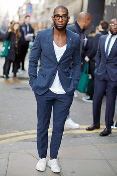 Shop this look on Lookastic: http://lookastic.com/men/looks/white-crew-neck-t-shirt-white-low-top-sneakers-navy-wool-suit/5157 — White Crew-neck T-shirt — White Low Top Sneakers — Navy Wool Suit