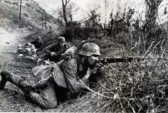 German soldiers have fallen under sniper fire on the road. They fire back. Yugoslavia.