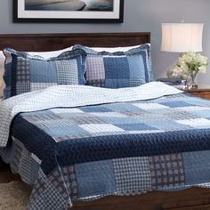 Stay warm while adding a classic look to your home with this blue patchwork quilt. Reversible for double the use, this quilt is finished with vermicelli embroidery to add both style and durability as well as scalloped edges for sophistication.