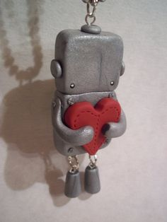 <3 :::: Clay robot necklace...cute!