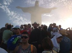 """Sunlight pours through the crowds, despite them standing in the shadow of the famous """"Christ the Redeemer"""" statue in Rio. Can you spot our intrepid """"Life on the Rock"""" co-hosts among the #WYD2013 pilgrims?"""