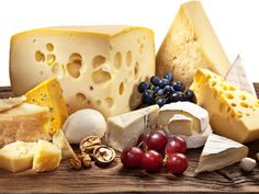 Different types of cheese over old wooden table. File contains clipping paths.
