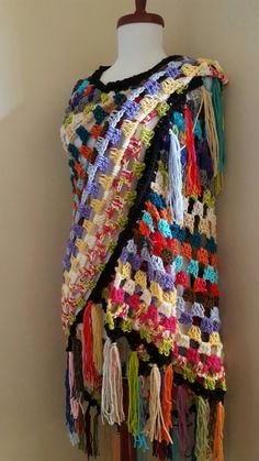 This one of a kind oversized scrappy granny stripe shawl will speak to your inner bohemian. It is crocheted in a wild riot of colors in an open and loose style with tons of fringe. It's the perfect topper over jeans or gypsy skirts. Perfect to wear to festivals or to the beach or just as a fun cover up when it gets a little cool. Each shawl is created individually by hand and no two are exactly alike. Measurements: approximately 56 inches wide by 44 inches long, not including the fringe.