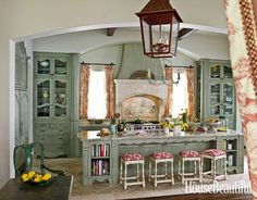 French-Inspired Red Kitchen - Love the stools