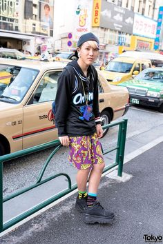 Kanata is an 18-year-old fashion student who we met in Harajuku His look includes galaxxxy pizza print shorts, a resale top, colorful socks and nail art, Buffalo platforms & a Game Boy Color. If you check the closeup pics, you can see he paused his game of Tetris so that we could take street snaps. #tokyofashion   #street snap   #Harajuku