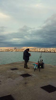 pescator fisherman