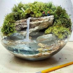 Bora tomar um banho de cachoeira pra Double-tap to see more awesome terrariums! Add a Miniature Waterfall Pond or River to your Fairy Garden