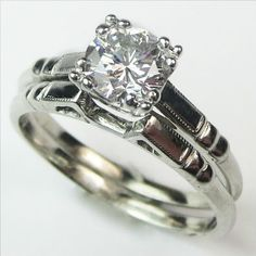 Dynamic Duo: This pristine set features a dazzling diamond, with subtle architectural details for just the right amount of vintage feel. The matching band has a scooped out area that lets them nestle perfectly flush to each other. Ca 1938. Maloys.com