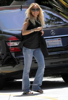 Nicole Richie wearing Paige Premium Denim Laurel Canyon Tonal Indigo Las Palmas Jeans in Beachwood House of Harlow 1960 Carmen Sunglasses in Black Winter Kate Iris silk crepe vest