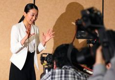 Figure skater Mao Asada waves after a press conference on her retirement on April 12, 2017 in Tokyo, Japan.
