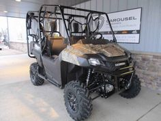"""New 2017 Honda Pioneerâ""""¢ 700-4 Deluxe Camo ATVs For Sale in Minnesota. GET THIS NEW 2017 HONDA PIONEER 700-4 DELUXE NOW ON SALE FOR A GREAT PRICE AT CAROUSEL MOTORSPORTS IN DELANO. Please call for current price as manufacturer allows advertising only MSRP. MSRP on this Pioneer is $ 13,499.00 + $ 670.00 freight. The updated Honda Pioneer 700-4 Deluxe. Honda took the best of it's Pioneer options and dressed it up with the Deluxe package, giving you the most features and best value in…"""