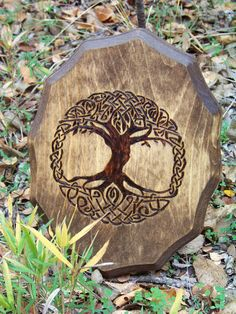 "This delicately stylized 'Tree of Life' is represented by celtic knotwork showing the connection between heaven and earth,  Stained a lovely walnut finish and sealed for protection.  Great for an altar or a mantle.  Measures approximately 11""x 81/2"""