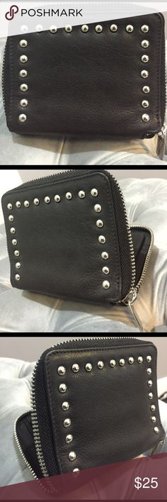 Genuine leather silver studded wallet Genuine leather silver studded wallet. Never used. $49 original price. Modern. Edgy. Soft but sturdy leather. Gorgeous gift! Bags Wallets