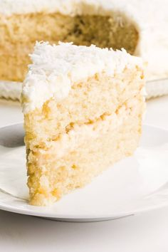 Enjoy a slice of this FABULOUS easy Vegan Coconut Cake recipe. Each bite is the perfect combination of sweet coconut, creamy frosting, and vanilla cake. If you love coconut recipes, you will be head over heels for this cake, made without eggs and dairy. Healthy coconut cake is so flavorful and delicious! Enjoy layers of coconut milk cake, topped with a whipped, creamy frosting and coconut flakes. #vegan #coconut #cake #namelymarly #coconutcake #coconutrecipes Coconut Cake Easy, Vegan Coconut Cake, Coconut Recipes, Vegan Cake, Coconut Milk, Best Vegan Desserts, Vegan Treats, Easy Cake Recipes, Sweets Recipes