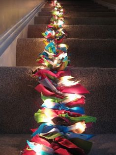 Easy to throw together this garland, just tie your favorite seasonal ribbon onto a string or two of lights and you're done!