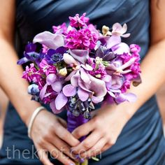 The bridesmaids carried a monochromatic mix of deep pink and purple hydrangeas, orchids, anemones, and calla lilies.